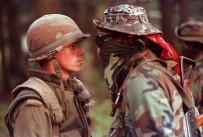 Army sentry, and Anishinaabe warrior facing off during Oka Crisis