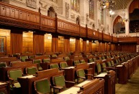 Row of empty seats in Canadian House of Commons