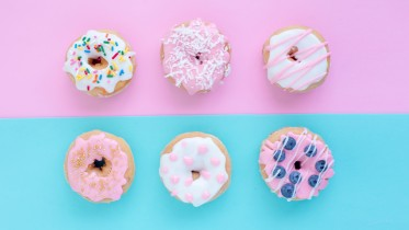 Donuts repeated on background