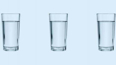 Glass of water repeated on background