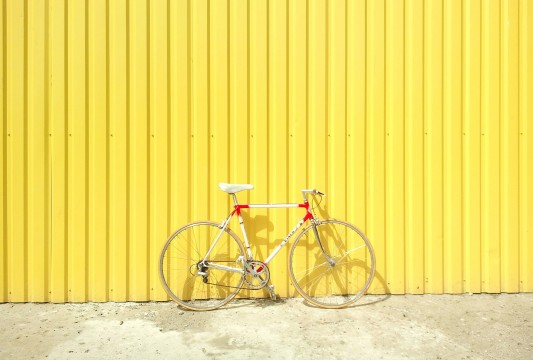 Bike in front of bright yellow background