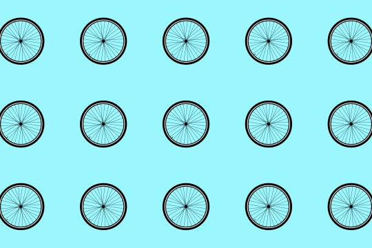 Bicycle wheels repeated on background