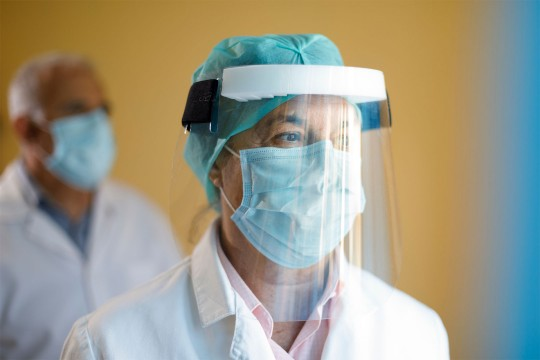 Doctor wearing medical protection equipment