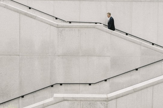 Businessman on concrete stairs