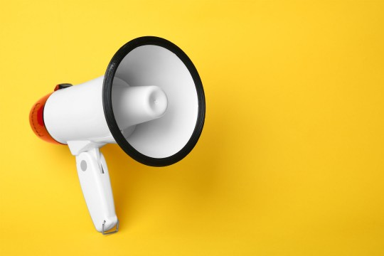 Megaphone on yellow background