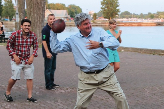 NATIONAL's Luc Beauregard playing football with employees