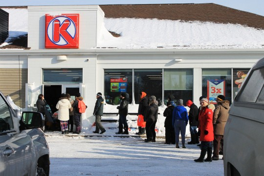 People waiting in line at store in St. John's