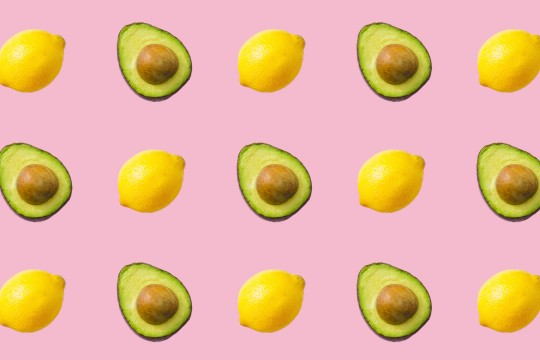 Avocados and lemons repeated on background