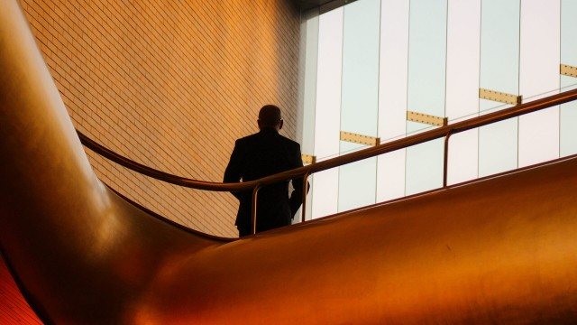 Business man in modern building looking out
