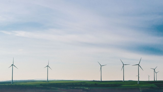 Wind turbines on sky background